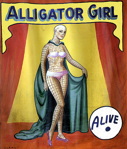 "vintage side show art of a supposed ""alligator girl"""